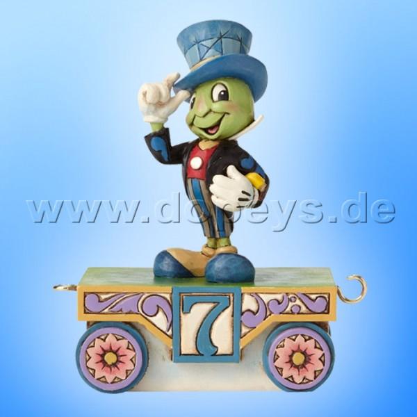 "Disney Traditions / Jim Shore Figur von Enesco ""Jiminy Cricket - Geburtstagszug Jahr 7"" 4055417."