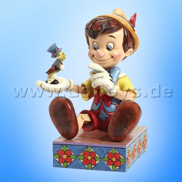 "Disney Traditions / Jim Shore Figur von Enesco. ""Just Give a Little Whistle (Pinocchio 75 Jahre Jubiläumsfigur)"" 4043647."